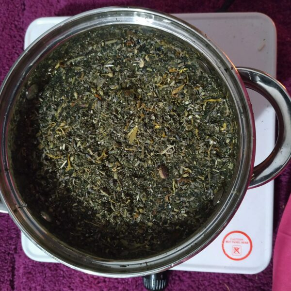 pan with yoni herbs and water